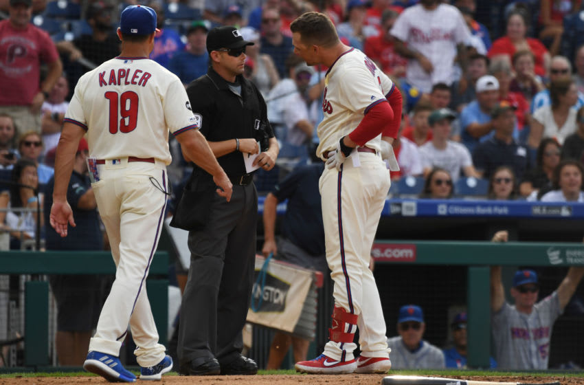 Rhys Hoskins appears to curse out umpire after potential game-tying home run is wiped off the board (Video)